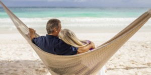 o-OLDER-COUPLE-IN-HAMMOCKS-ON-BEACH-facebook