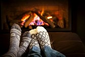 20240032-feet-in-wool-socks-warming-by-cozy-fire