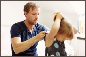 Young father helping his daughter get ready