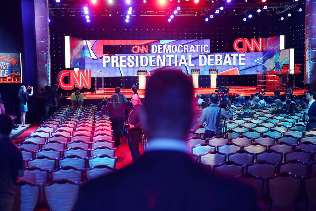 LAS VEGAS, NV - OCTOBER 13: Journalists check out the debate stage during a walk-through before the Democratic Presidential candidates arrive for their CNN Facebook Democratic Debate this evening at the Wynn Las Vegas on October 13, 2015 in Las Vegas, Nevada. Democratic presidential candidates are schedule to be participating in the party's first presidential debate. (Photo by Joe Raedle/Getty Images)