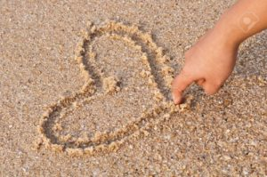 9329979-writing-heart-on-beach-stock-photo